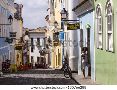 SALVADOR, BRAZIL - AUGUST 01, 2012: Horizontal photo of one of the streets in the historical old town of Salvador, the capital of the Bahia Region. Colorful colonial architecture, people on the street - stock photo
