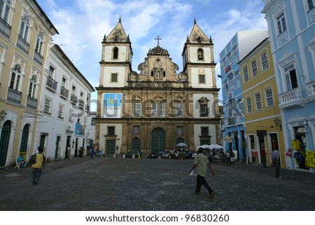 SALVADOR, BRAZIL - AUGUST 1:  Pedestrians walk past the church of Sao Francisco in the Pelourinho area August 1, 2005 of Salvador, Brazil. - stock photo