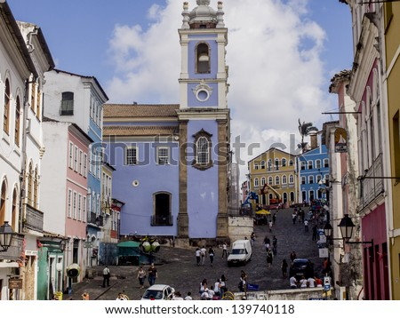 SALVADOR, BRAZIL - JULY 30: Largo do Pelourinho in the historical center in Salvador, Brazil on July 30, 2012. The colonial architecture of the old town of Salvador is the main attraction of the city. - stock photo