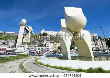 "SALVADOR, BRAZIL - MARCH 12, 2015: Modern sculpture known locally as the ""bunda"" dominates the view of the city skyline from the Cairu Plaza. - stock photo"