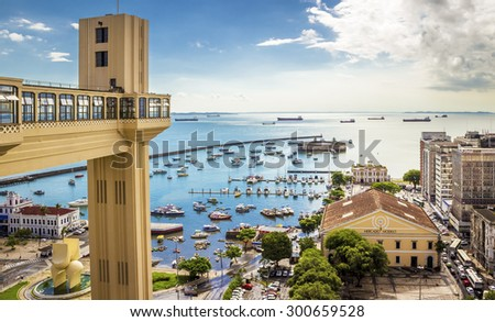 SALVADOR, BRAZIL - MAY 7: Panoramic view of Salvador in Bahia, Brazil with the  historic architecture of Elevador Lacerda lift and Mercado Modelo Market at Bahia de Todos os Santos Bay on May 7, 2015. - stock photo