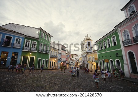 SALVADOR, BRAZIL - OCTOBER 12, 2013: Tourists and locals mix in a plaza as dusk falls over the historic city center of Pelourinho. - stock photo