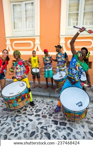 Salvador, Brazil - September 2013: Pelourinho district, exhibition of traditional drummers in Porta dos Carmo street - stock photo