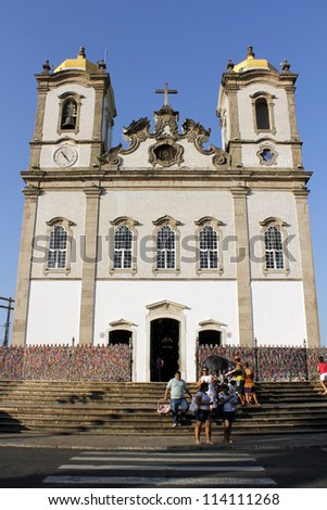 SALVADOR, BRAZIL - SEPTEMBER 21: People leaving the Bonfim church, built in the 18th century and subject of religious devotion by the people of Salvador on September 21, 2012 in Salvador, Brazil. - stock photo