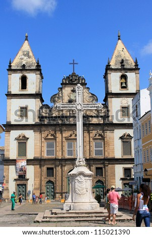 SALVADOR, BRAZIL - SEPTEMBER 23: Unidentified tourists walk in front of St. Francis of Assisi Church in Historic Centre (Pelourinho) of Salvador de Bahia on September 23, 2012 in Salvador, Brazil. - stock photo