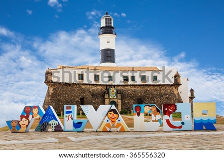 Salvador - DECEMBER 28, 2015: The Barra's Lighthouse (Farol da Barra) located in Salvador, Bahia (one of the most popular parts of Brazil along the east coast). - stock photo