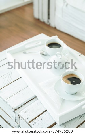 Salver with cups of coffee, standing on handmade, wood, small table