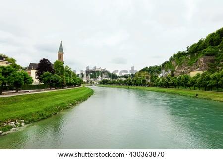 Salzach River in Salzburg, Austria. Famous place (Unesco Heritage) Festung Hohensalzburg, Salzburger Land, Austria, Europe - stock photo