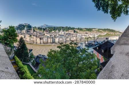 SALZBURG, AUSTRIA - AUGUST 01, 2014: Salzach river on its way through Salzburg city, Austria - stock photo