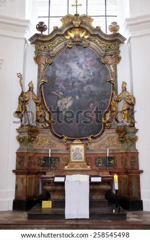 SALZBURG, AUSTRIA - DECEMBER 13: Altar in Collegiate church in Salzburg on December 13, 2014. - stock photo