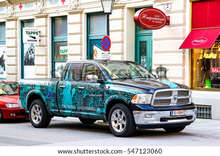 SALZBURG, AUSTRIA - JULY 28, 2014: American pickup truck Dodge Ram 1500 in the town street.