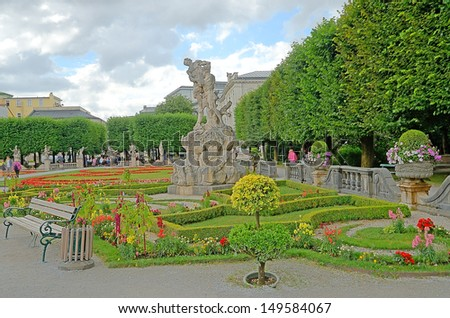 SALZBURG, AUSTRIA - JULY 30: Mirabell gardens on July 30, 2013 in Salzburg, Austria. Gardens were opened to public in 1854. Today they are a horticultural masterpiece and  popular tourist destination.