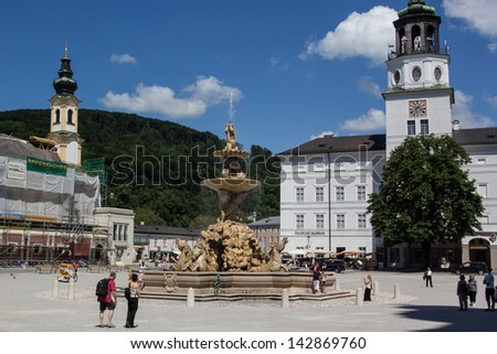 SALZBURG,AUSTRIA-JUNE 16: Tourists visit the horse statue in the old town of Salzburg on June 16, 2013. Salzburg was listed as a UNESCO world heritage site in 1997.