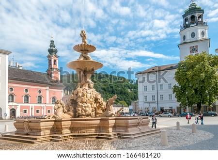 SALZBURG, AUSTRIA - SEPTEMBER 7,2010 - The Horse Fountain in Residenplatz.Salzburg was the birthplace of 18th-century composer Wolfgang Amadeus Mozart. - stock photo