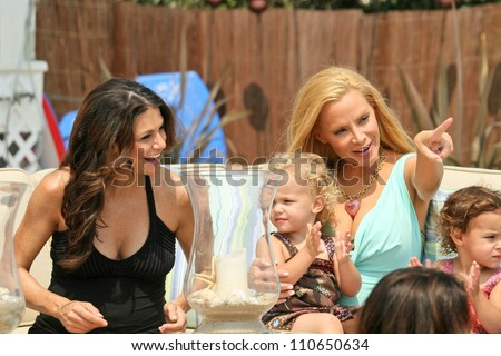 "Samantha Harris with Cindy Margolis and family at the Hot Moms Video Shoot for ""Beautiful Now(the Hot Moms Song)"". Silver Spoon House, Malibu, California. 08-15-07 - stock photo"