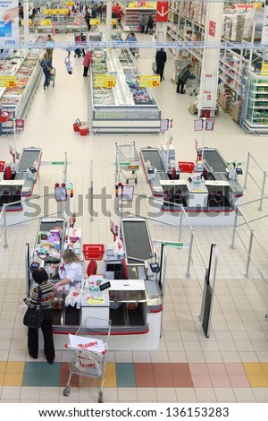 SAMARA - MAY 5: Woman make purchases in Auchan superstore, on May 5, 2012 in Samara, Russia. French distribution network Auchan unites more than 1300 shops.