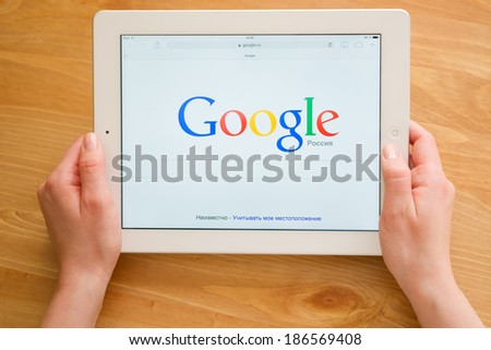 Samara, Russia - April 08, 2014: A Google search home page on a ipad screen, new app for mobile devices - stock photo