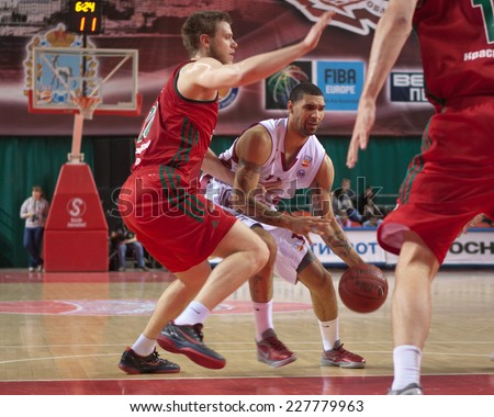 SAMARA, RUSSIA - APRIL 06: Chester Simmons of BC Krasnye Krylia with ball tries to go past a BC Lokomotiv-Kuban player on April 06, 2013 in Samara, Russia.