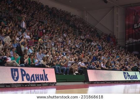 SAMARA, RUSSIA - APRIL 21: Fans and spectators enjoyed on tribunes at the game between BC Krasnye Krylia and BC CSKA on April 21, 2013 in Samara, Russia. - stock photo
