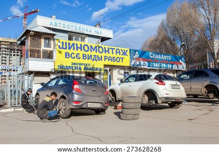 SAMARA, RUSSIA - APRIL 11, 2015: Mass replacement of automobile wheels winter to summer - stock photo