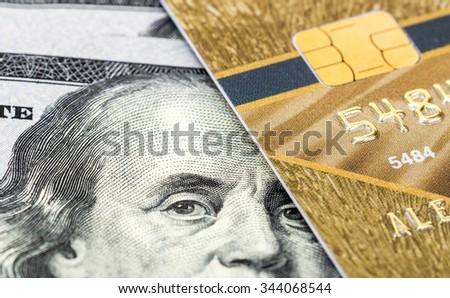 SAMARA, RUSSIA - APRIL 10, 2015: Mastercard Debit Card with US dollar bills - stock photo