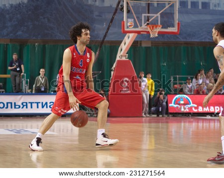 SAMARA, RUSSIA - APRIL 21: Milos Teodosic of BC CSKA, with ball, is on the attack during a BC Krasnye Krylia game on April 21, 2013 in Samara, Russia. - stock photo