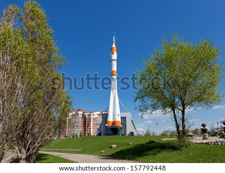 "SAMARA, RUSSIA - APRIL 25: Real ""Soyuz"" type rocket as monument on April 25, 2012 in Samara. Rocket height together with building - 68 meters, weight - 20 tons. The monument was unveiled on 2001 - stock photo"