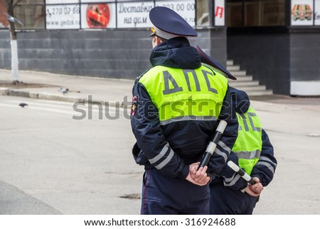 SAMARA, RUSSIA - APRIL 26, 2015: Russian police patrol of the State Automobile Inspectorate - stock photo