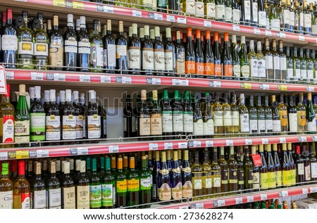 SAMARA, RUSSIA - APRIL 12, 2015: Showcase alcoholic beverages at the hypermarket Magnet. Russia's largest retailer. It was founded in 1994 in Krasnodar - stock photo