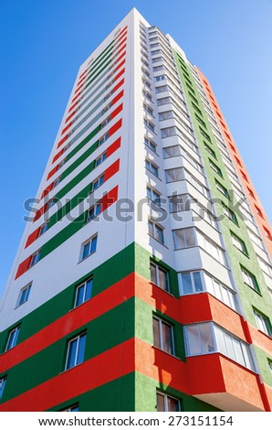 SAMARA, RUSSIA - APRIL 12, 2015: Tall apartment buildings under construction against  blue sky background - stock photo