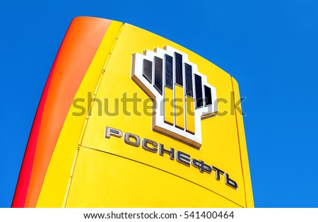 SAMARA, RUSSIA - APRIL 16, 2016: The emblem of the oil company Rosneft against the blue sky background. Rosneft is one of the largest russian oil companies