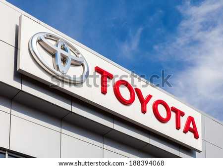 SAMARA, RUSSIA - APRIL 19, 2014: The emblem Toyota on the office of official dealer. Toyota Motor Corporation  is a Japanese automotive manufacturer headquartered in Toyota, Aichi, Japan