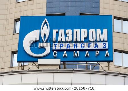 "SAMARA, RUSSIA - APRIL 26, 2015: The logo of Gazprom on the facade of the administrative and supervisory office of LLC ""Gazprom Transgaz Samara"" - stock photo"