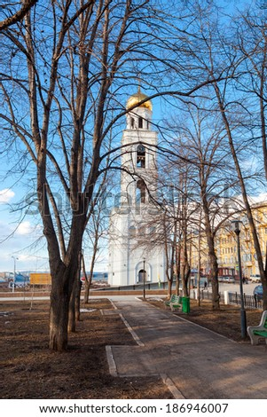 SAMARA, RUSSIA - APRIL 10, 2014: View on belltower of Iversky monastery in spring day. Monastery was founded in 1850. Belltower reconstruction in 2014