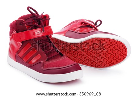 SAMARA, RUSSIA - August 17, 2015: Adidas sneakers for running, training, in red, showing the Adidas logo and famous three stripes, illustrative editorial
