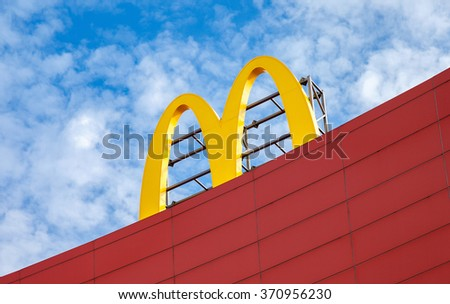 SAMARA, RUSSIA - AUGUST 29, 2015: McDonald's logo against the blue sky. McDonald's is the world's largest chain of hamburger fast food restaurants - stock photo