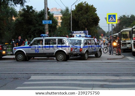 Samara, Russia - August 21, 2014: the detention of criminals. A detachment of police officers, the arrest of criminals in Samara, Russia - August 21, 2014. Strangers - witnesses of the incident. - stock photo