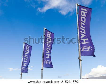 SAMARA, RUSSIA - AUGUST 30, 2014: The flags of Hyundai over blue sky. The Hyundai Motor Company is a South Korean multinational automotive manufacturer headquartered in Seoul, South Korea - stock photo