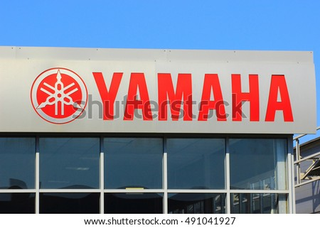 Samara, Russia - August 30, 2016. the sign and logo manufacturer YAMAHA over the entrance to the service center