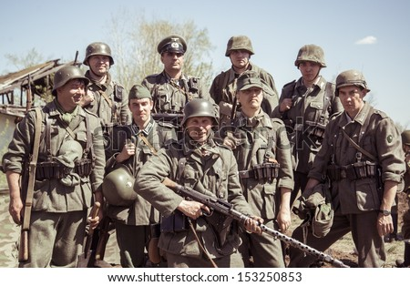 SAMARA, RUSSIA - CIRCA MAY 2013: An unidentified members of several history clubs wear historical german uniform during historical reenactment of WWII