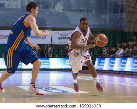 SAMARA, RUSSIA - DECEMBER 17: Aaron Miles of BC Krasnye Krylia with ball tries to go past a BC Khimki player on December 17, 2012 in Samara, Russia. - stock photo