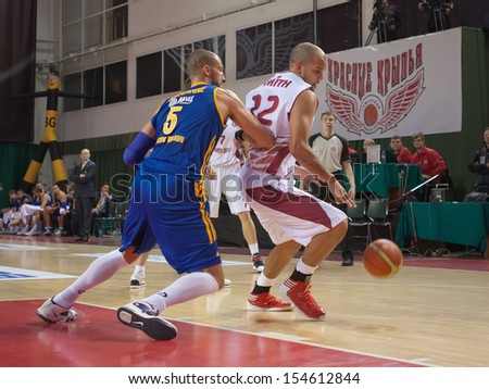 SAMARA, RUSSIA - DECEMBER 17: Andre Smith of BC Krasnye Krylia with ball tries to go past a BC Khimki player on December 17, 2012 in Samara, Russia. - stock photo