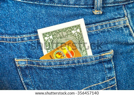 SAMARA, RUSSIA - DECEMBER 23, 2015: Banknote of one american dollar and Credit card Mastercard sticking out of the back jeans pocket - stock photo