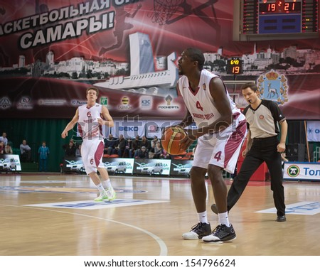 SAMARA, RUSSIA - DECEMBER 17: Omar Tomas of BC Krasnye Krylia, with ball, is on the attack during a BC Khimki game on December 17, 2012 in Samara, Russia. - stock photo