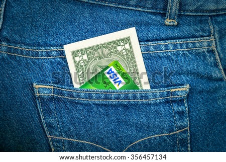 SAMARA, RUSSIA - DECEMBER 23, 2015: One american dollar and Credit card Visa sticking out of the back jeans pocket - stock photo