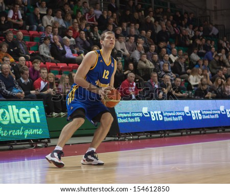 SAMARA, RUSSIA - DECEMBER 17: Sergey Monya of BC Khimki, with ball, is on the attack during a BC Krasnye Krylia game on December 17, 2012 in Samara, Russia. - stock photo
