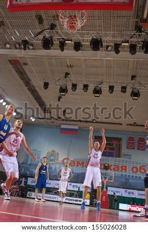 SAMARA, RUSSIA - DECEMBER 17: Yury Vasiliev of BC Krasnye Krylia scored a goal from the free throw line in a game against BC Khimki on December 17, 2012 in Samara, Russia. - stock photo
