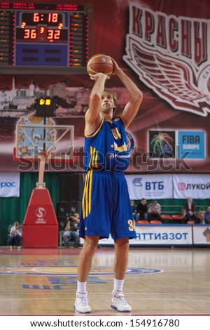 SAMARA, RUSSIA - DECEMBER 17: Zoran Planinic of BC Khimki throws from the free throw line in a game against BC Krasnye Krylia on December 17, 2012 in Samara, Russia. - stock photo