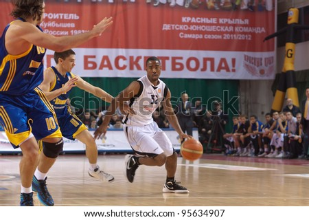 SAMARA, RUSSIA - FEBRUARY 04: Aaron Marquez Miles of BC Krasnye Krylia, with ball, is on the attack during a BC Khimki game on February 04, 2012 in Samara, Russia.