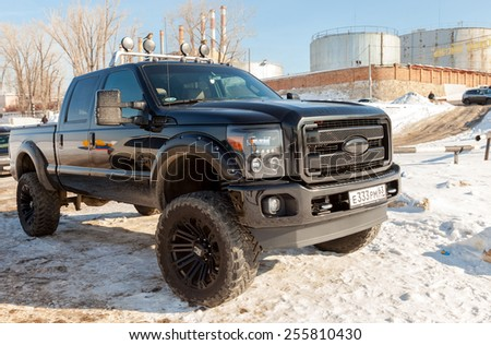 SAMARA, RUSSIA - FEBRUARY 23, 2015: Off-road 4x4 car Ford on the road in the wintertime close-up - stock photo